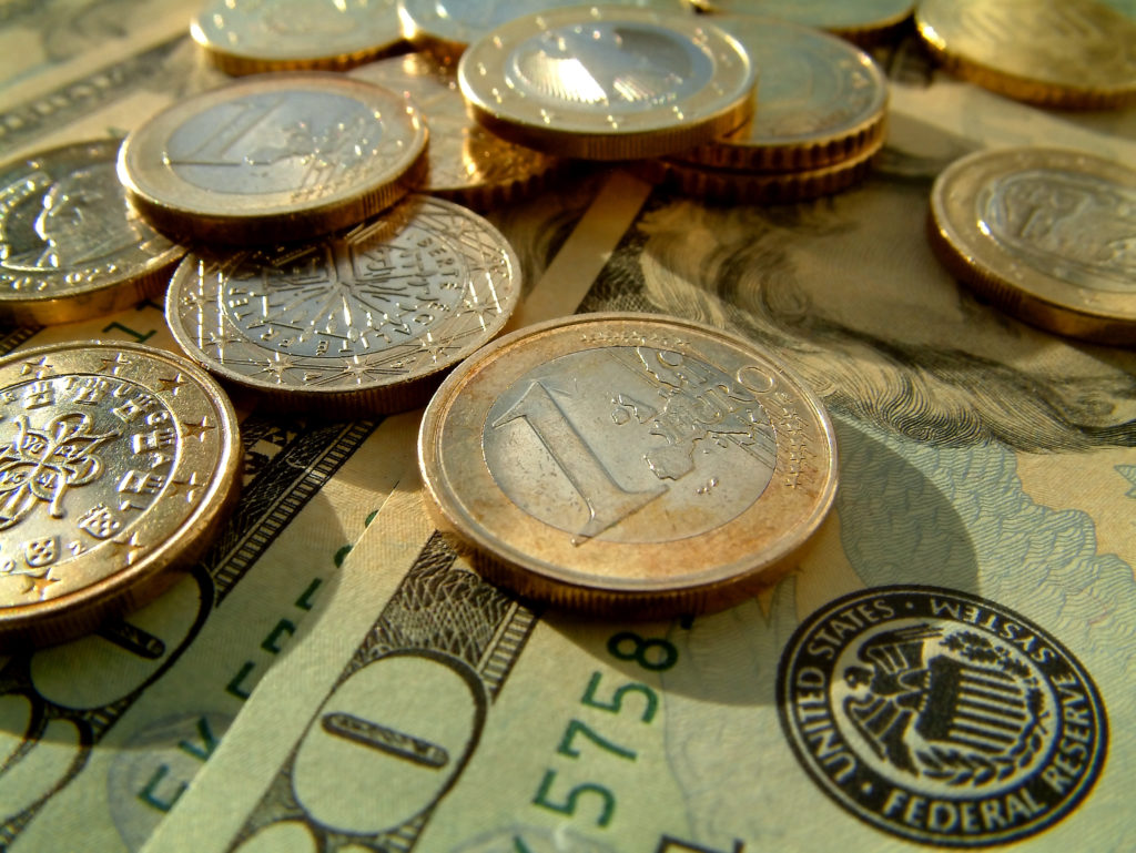 US dollars and euro coins