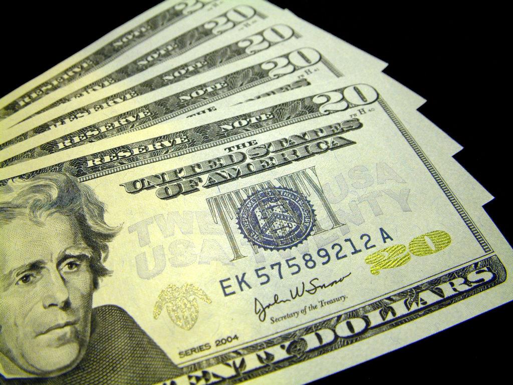 US dollars on black